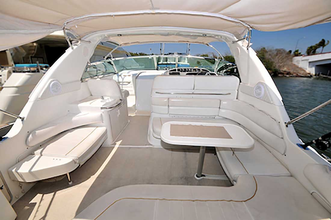 37-ft.-SeaRay-Sundancer-Power-Yacht-Up-to-10-People-Boarding-Deck-under-shade-with-Round-lounges-table-we-tbar-Helm-Station