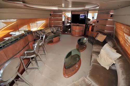 98-Ft.-Azimut-Leonardo-Ample-Fully-Furbished-AC-Salon-with-plenty-of-seats-wet-bar-dinner-table-and-Entertainment-Center